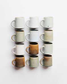 Twelve hand thrown mugs, made with three-hundred grams of clay, trimmed only a touch and finally a pulled handle is attached. Ceramic Cups, Ceramic Pottery, Slab Pottery, Butterworth, Keramik Design, Ceramic Glaze Recipes, Kitchenware, Tableware, Wheel Thrown Pottery