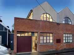 Industrial warehouse space converted to a residence. I love this type of dwelling.