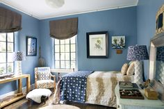 Eclectic Rustic Kids' Room: Blue-painted walls and brown curtains in a kids' room  .