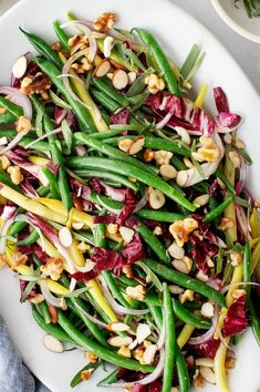 This fresh green bean salad recipe is an easy, delicious side dish! It's made with almonds, red onion, goat cheese, and a tangy honey mustard dressing. | Love and Lemons #greenbeans #salad #sidedish Fresh Green Bean Casserole, Sweet Potato Casserole, Bean Salad Recipes, Healthy Salad Recipes, Veggie Recipes, Delicious Recipes, Crockpot Recipes, Vegetarian Recipes, Green Bean Salads