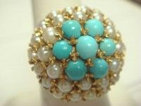 Here is an 18KT GOLD Pearl and Tourquoise Ladies Cluster Ring size 7 weighing 9.6 Grams.