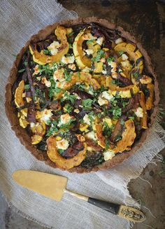 This Mixed Baby Greens, Delicata, Caramelized Onions and Feta Tart is full of fall deliciousness! It's the perfect vegetarian main dish for Thanksgiving!