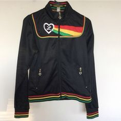 Luxirie Designer Zip Up Jacket Luxirie designer zip up jacket. Black trimmed with red, yellow and green. 100% polyester. Gently worn. Fitted style with warm lining. Great details. Front zip pockets. Size medium. ❌ NO TRADES ❌ NO PP❌ NO LOWBALLING ❌ Lux Jackets & Coats