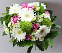 White Gerbera, Pink Roses, Green Dianthus, Alstroemeria, Chrysanthemum and greens in a lovely hand-tied bouquet.
