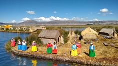 Lake Titicaca surrounded by beautiful snow-capped mountains. Lake Titicaca is the perfect place to end our tour.