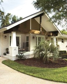 a bungalow with a modern twist...exposed rafters in the porch roof are both decorative and structural, as are the columns.