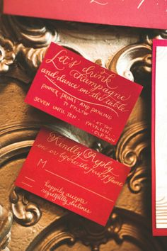 Margaret Madeleine Calligraphy designed the exquisite gold and red invitations, and table numbers that helped bring this speakeasy wedding to life. // La Candella Wedding Photography http://www.confettidaydreams.com/speakeasy-wedding/