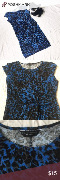 """Dorothy Perkins leopard print twist front dress. Blue/black leopard print twist front dress from Dorothy Perkins. Very stretchy, jersey material and extremely comfy. 41 inches from shoulder to hem. I'm 5'7"""" and it hits me just past my knees. Only flaw is a small white line in the back on the bottom right side that was there when it came. Not very noticeable! U.K. 16, U.S. 14. Dorothy Perkins Dresses Midi"""