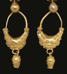 A PAIR OF GREEK GOLD EARRINGS   CLASSICAL PERIOD, CIRCA 4TH CENTURY B.C.   Each boat shaped, with a high-arching earwire, ornamented with filigree spirals and diamonds in granulation, each end with a ring of granulation framed by plain rings, a loop at the bottom suspending a pomegranate-shaped pendant adorned with granulation; with modern gold ear-posts