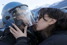 Protester plants a tender kiss on riot cop - Protester plants a tender kiss on riot cop By David R Arnott : NBC News PhotoBlog