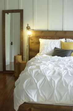 What a fabulous contrast between the weathered boards, simplistic design, and the white luxurious comforter!  Eclectic bedroom by Christopher Kellie Design Inc.