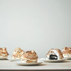 """Baked's baked Alaska meringues - Sure, there's nothing really """"Alaskan"""" about baked Alaska. But we'll take it -- who doesn't love ice cream, cake and meringue? Mini Desserts, Frozen Desserts, Frozen Treats, Just Desserts, Delicious Desserts, Dessert Recipes, Cupcakes, Cupcake Cakes, Mini Cakes"""