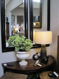 something like this for entry...but use your one black mirror, table lamp and some greenery with small accessories
