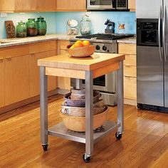 I wish I had just a bit more space in my kitchen, even a small moveable island like this would be nice.