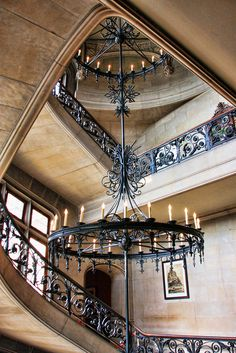 Beautiful Stairway to Foyer with gorgeous oversized wrought iron chandelier / hanging light fixture
