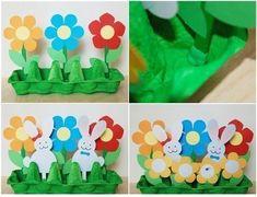 Забавная объемная поделка с весенним настроением. Используя картонный лоток для яиц, сделаем зеленую полянку с бумажными цветами и зайцами.