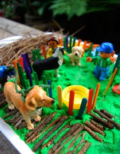 A miniature dog park with playdough as the base...perfect for little doggie footprints