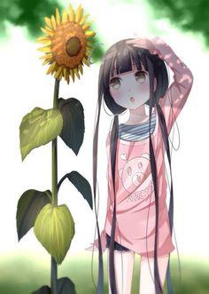 Petite fille et un tournesol