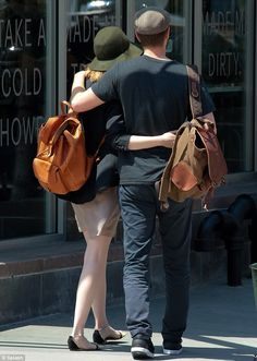 Matchy matchy: Emma Stone and Andrew Garfield strolled with arms around each other, sporting co-ordinated backpacks -- Will Leather Goods #backpack