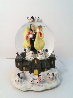 "Disney 101 Dalmations Cruella de vil Musicial Snowglobe in Box Retired | eBay  101 Dalmations Description: The wickedly wonderful Cruela DeVil inspires this snowglobe that has a base sculpted to look like her mansion and is adorned with racally pups. Characters: Cruella De Vil, Puppies. Features: Music: ""Cruella DeVil"" Size: 7 ¼"" tall x 5 1/2"" wide at base. Snow: Source: Disney Catalog; Theme Parks. Timeframe: 1997  ORP: 55.00"