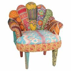 "Crafted from mango wood with a peacock-style back and vintage kantha cloth upholstery, this one-of-a-kind accent chair brings bright bohemian-inspired style to your decor.   Product: ChairConstruction Material: Mango wood and vintage cottonColor: MultiFeatures: One-of-a-kindDimensions: 29"" H x 20"" W x 33"" D"