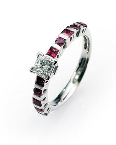 Half carat half eternity ring in 18ct white gold set with a certified H VVs1 0.51carat princess cut diamond and 0.80cts diamond cut rubies.
