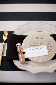 Printed menu bound in an embroidery ring - I love this but HOLY HELL! Who has that kind of time?