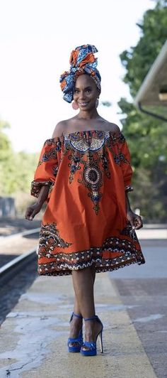 African Clothing: N Y O T A African Print Dress In Orange. Nyota African print mini dress is made with Angelina Wax fabric. Causal sexiness for summer with its off the shoulder detailing and 3/4 bishop sleeves. Available with or without lining. Ankara   Dutch wax   Kente   Kitenge   Dashiki   African print dress   African fashion   African women dresses   African prints   Nigerian style   Ghanaian fashion   Senegal fashion   Kenya fashion   Nigerian fashion (affiliate)