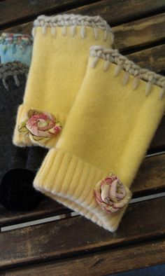 Repurposed wool sweaters. Felt 100% wool sweater, cut off 2 pieces from the cuff end of sleeve. Add a row of blanket stitch, then single crochet around. You can add a button to the cuff, or this time I made a fabric flower. Toasty