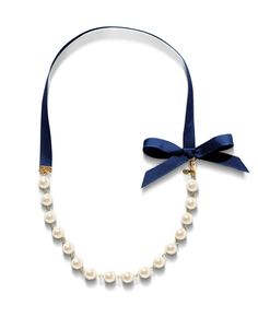 A strand of pearls with a navy ribbon <3