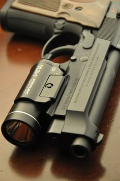 Beretta 92A1. Basically an improved version of my dad's 92FS