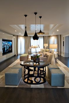 Black lights against stark white. large windows with sheer treatments. Comfy, yet sophisticated sofa. I think I love everything except the seating around the forward facing table.