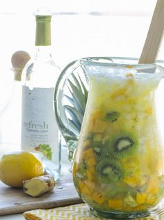 Fizzy White Wine Sangria  1 bottle Turning Leaf Refresh,  Crisp White 1 mango,  peeled and diced 1 pineapple,  peeled and cubed 3 kiwis,  peeled and sliced 3 tablespoons lemon juice 1/8 cup minced ginge...