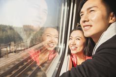 Chinese couple looking out train window