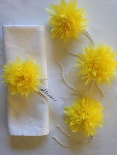 Perfect for Easter! Yellow paper dahlia place card holders.