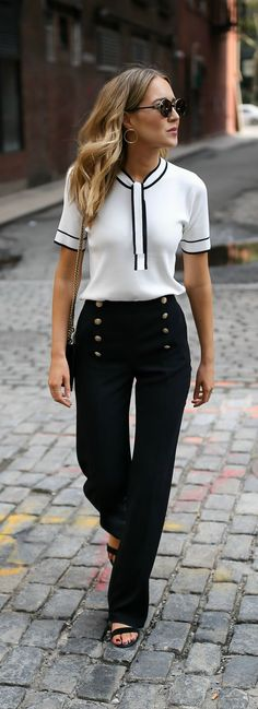 White tie neck knit top with black piping, navy sailor inspired button front pants, black ankle strap block heel sandals + classic leather crossbody bag. Office fashion ideas to boost your c… Office Fashion, Work Fashion, Trendy Fashion, Fashion Outfits, Womens Fashion, Fashion Trends, Fashion Black, Fashion Heels, Style Work