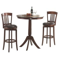 The Canton is a 360-degree swivel barstool with dark brown faux leather seat, a traditional mission back design and simple, tapered and slightly flared legs. The bar height table complements the bar stools with a slender pedestal base.