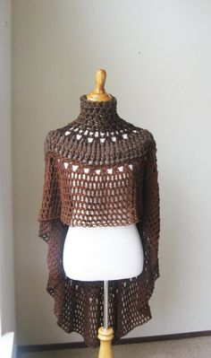 ONLY S/M size.   This beautiful poncho was handmade using a combination of yarns and variety of stitches and crochet . This intricate design is fashionable and unique to this garmet. Its elegant , yet casual, can be worn with jeans and boots or with your yoga pants. It is perfect for the winter season and the close neck provides warmth and comfy feeling around the party atmoshere.  It measures 15 inches long in front ,around the neck is 18 inches wide, in the back is 41 inches long . Falls…