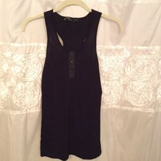 BCBG black tank Black BCBG tank with cute buttons and detailing on the front and a pretty racerback cut in the back. Barely worn. Greattttt for summer! It's really hard to see the details since its black so go and look at the grey version of this tank so you can better see what it looks like!!! BCBGMaxAzria Tops Tank Tops