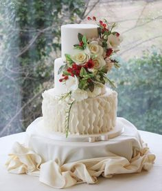 Winter bespoke winter wedding cake with vertical ruffles and handmade sugar flowers.