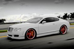 car all white with red wheels... Yes