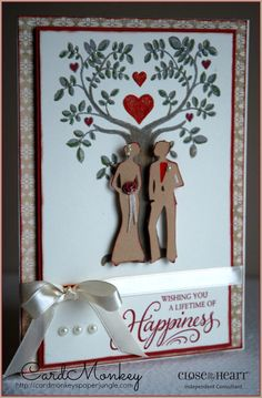 "This card uses CloseTo My Heart's Stamp of the Month for September 2014 (S1409), paper cuts (bride & groom) from CTMH's Cricut ARTISTE cartridge, sentiment stamp from CTMH called ""Happy Couple"" and paper from the NEW ""Yuletide Carol"" collection. All CTMH supplies are available from my website, http://cardmonkey.ctmh.com. Thank you!"