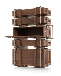 The Cabinet of Chests was created by Wouter Scheublin in 2008 as part of a series of Chests. Ultimately, the stacked chests become a cabinet with a beautifull repetitive character. Cabinet of Chests is made in a limited edition of 8. The robust yet fine & detailed piece is carefully crafted from solid walnut wood with stainless steel fixings. As one of the oldest pieces of furniture, a chest has always been a fascinating object. The trivial principle of a contained volume is nonetheless…