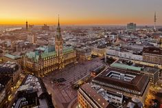 Germany, Hamburg, View of town with town hall at sunset. Cosmopolitan, Portal, Like A Local, Town Hall, Paris Skyline, Sunset, Hamburg Germany, City Guides, Destinations