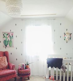 Western style nursery on point! @youngbrokefabulous used our peel-and-stick cactus decals to add charm to this cute space. And just how adorable is the llama head mount?! #decor #room #living #interior