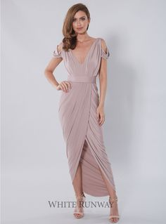 Exclusive Dionne Dress. A grecian inspired maxi dress with wrap skirt by designer Pia Gladys Perey. Features beautifully draped scooped wrap-style skirt and draped shoulder deta