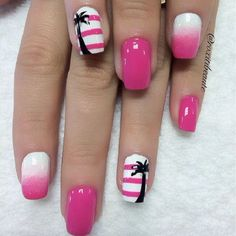 Pink and white Palm Tree Nail Art design. The bold color of the pink hue gives a striking contrast to the white polish which creates a wonderful gradient design as well. The black palm trees serve as silhouette to the light design.