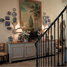 Idea for arrangement in next home with Emperor painting flanked by blue and white plates over a buffet.