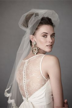 Add illusion neckline and sheer back with buttons to a strapless wedding dress