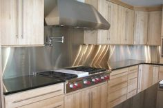 Stainless Steel Kitchen Backsplash Home Design Planning to Home Interior Adding a stainless steel backsplash is a simple enough and cheap way to protect the walls and cause them to become look great too. Stainless Backsplash, Stainless Steel Kitchen, Kitchen Backsplash, Backsplash Ideas, Backsplash Design, Sheet Metal Backsplash, Kitchen Redo, Kitchen Remodel, Kitchen Cupboard
